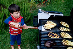 boy grilling some eggplant