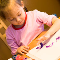 preschool pressure girl finger painting